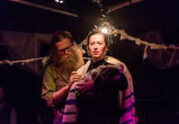 A touching moment with actors Ben Caplan and Mary Fay Coady during Hannah Moscovitch's new play Old Stock: A Refugee Love Story | Stoo Metz Photography
