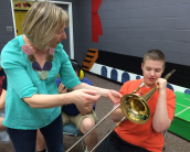 Andrew discovers the trombone at a Music Circle workshop with the NAC's Elizabeth Simpson | Photo submitted