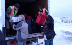 Loading luggage into the truck at Iqaluit airport | photo: Marnie Richardson