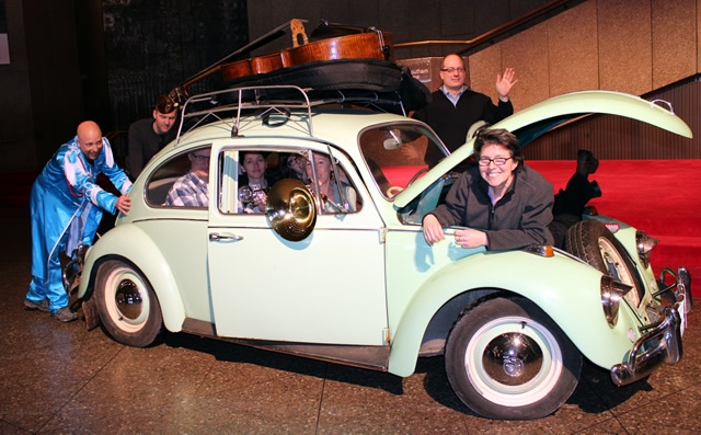 Mike Caluori, Head of Props pushes his 1967 VW Beetle filled with NAC Orchestra musicians