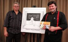 Ron and Brian Boychuk with their latest book and Ron's first cartoon illustration