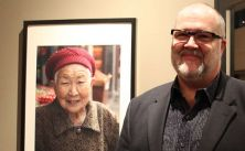 Colin Traquair (NAC Orchestra, trombone) with a photograph of a woman he met in Chongqing.